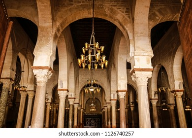 KAIROUAN, TUNISIA - JUNE 24, 2018: The interior of the Grand Mosque. Kairouan is a UNESCO World Heritage site, founded by the Umayyads around 670 in Tunisia.