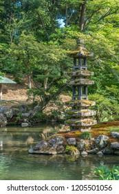 Kaiseki-to lantern in Hisagoike pond at Kenrokuen Garden. Kanazawa City, Ishikawa prefecture, Japan
