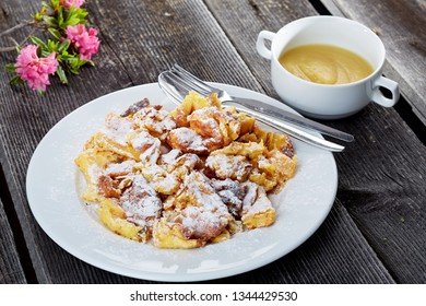 kaiserschmarrn with apple sauce on old wooden boards