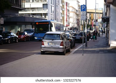 KAISERSLAUTERN, GERMANY - SEPTEMBER 17: Parking cars and bus traffic in Richard-Wagner-Street, a residential and commercial street on September 17, 2018 in Kaiserslautern.