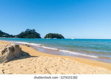 Kaiterteri golden sandy beach in Tasman district of South Island  New Zealand creates magnificent background.