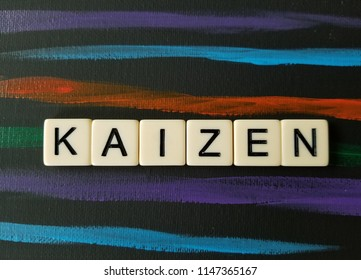 Kaizen in letters on black and multi colored background