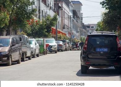 Kaizhou, Chongqing/CHINA - March 25, 2018: Chinese Township Parking