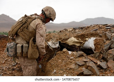 Kajaki, Afghanistan - April 22, 2012: US Marine prepares C4 charges to destroy and enemy fighting position.