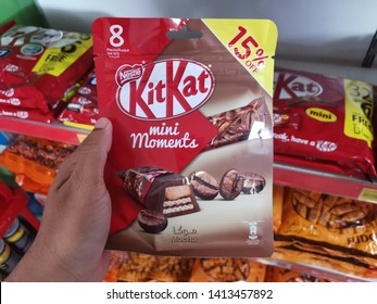 kajang - malaysia, 2 june 2019: hand holding one pack of kitkat mini moments edition from nestle brand in market with blur background