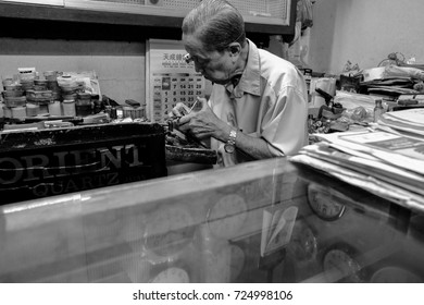 Kajang, Malaysia 23 September 2017 : Veteran Chinese clock smith repairing broken watch in his workshop at Kajang Market.