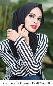 Kajang, Malaysia - December 2018 : Portrait of beautiful young Muslim girl wearing Hijab and Jubah dress. Muslim Fashion concept.