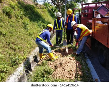 Kajang, Selangor, Malaysia, July 26 2019: Telekom Malaysia (TM) contractor is doing cabling work at road. Foreign worker is commonly hired by local contractor company.