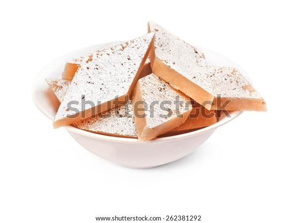 Kaju Katli Indian sweet dish isolated on white background