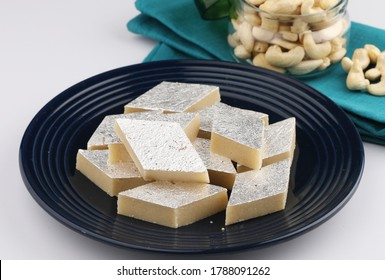 Kaju katli an Indian traditional sweet made from milk and cashews. served during Diwali, festivals and celebrations. almonds and cashews served with sweet