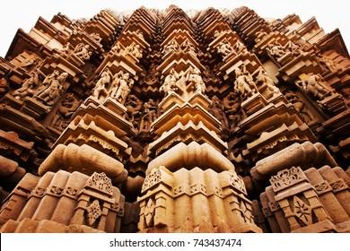KAJURAHO, INDIA - December 15, 2014: Kamasutra temple with bas reliefs showing erotic scenes in Kajuraho, India