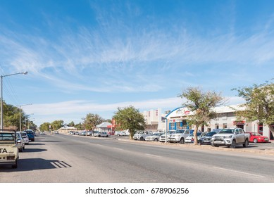 KAKAMAS, SOUTH AFRICA - JUNE 12, 2017: A street scene with businesses and vehicles in Kakamas in the Northern Cape Province