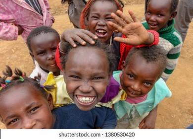 Kakamega quarry, Kenya - January 2nd, 2017: Poor Kenyan children enthusiastically posing for camera from a village adjacent to Kakamega quarry.