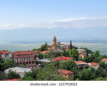 Kakheti, Georgia: Panoramic view on picturesque landscapes, pastel houses and narrow, cobblestone streets of Sighnaghi, Kakheti region. Architecture of Kakheti, popular tourist destination in Georgia