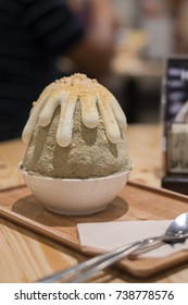 A Kakiori Japanese shaved ice dessert with sweet cream toppings, Hojicha Bingsoo or Bingsu. (soft focus)