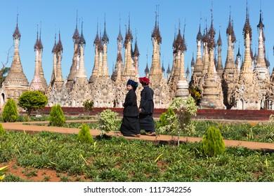 KAKKU, MYANMAR - NOVEMBER 29, 2014: People on pilgrimage to Kakku pagodas, nearly 2500 beautiful stone stupas hidden in a remote area of Myanmar