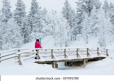 KAKSLAUTTANEN, LAPLAND - January 9th 2016: Bridge on the grounds of the Kakslauttanen Arctic Resort, Lapland, Finland