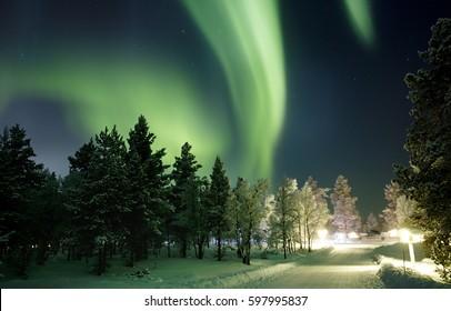 KAKSLAUTTANEN, LAPLAND - January 9th 2016: The Northern Lights over the Kakslauttanen Arctic Resort, Finland