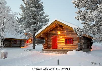 KAKSLAUTTANEN, LAPLAND - January 9th 2016: Wooden cabins at the Kakslauttanen Arctic Resort in Lapland, Finland