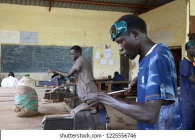 Kakuma refugee camp, Kenya - May 2018: Young man practising plumbing in Don Bosco vocational training centre. Tertiary education for refugees.