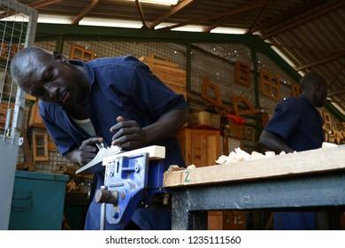 African Man Wood Work Images, Stock Photos & Vectors