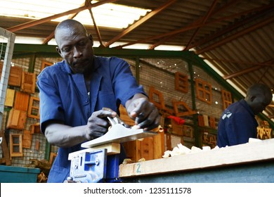 Kakuma refugee camp, Kenya - May 2018: South Sudanese refugee practising carpentry in Don Bosco vocational training centre in Kakuma refugee camp. Empowering refugees through practical skills.