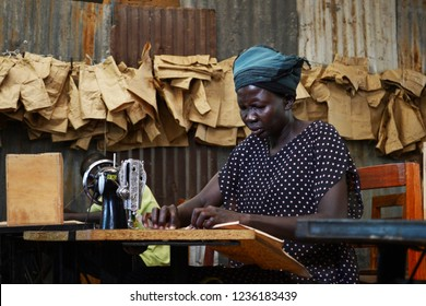 Kakuma refugee camp, Kenya - May 2018: Elderly woman is practising tailoring in the workshop. Practical skills for refugees offered by Don Bosco Kakuma.