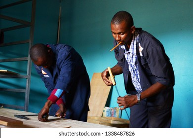 Kakuma town, Turkana region, Kenya - Young graduate of carpentry course working in his workshop in Kakuma town near Kakuma refugee camp.