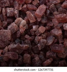 Kala namak background. black indian salt.