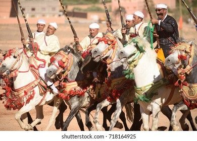 KALAAT M'GOUN, MOROCCO - MAY 12 2017: Local rider participates in a traditional fantasia event (or MOUSSEM in Arabic) which is mainly a hobby and sport event, during the festival of roses