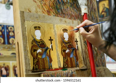 Kalabaka, Greece -may 18th, 2011: Artist paiting icons in icon painting studio in Kalabaka, Trikala regional unit, Greece