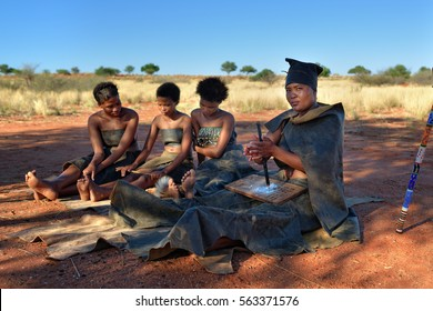 KALAHARI, NAMIBIA - JAN 24, 2016: Women in bushmen tribe village. The San people, also known as Bushmen are members of various indigenous hunter-gatherer peoples of Southern Africa