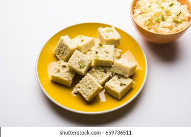 Kalakand is an Indian sweet is made from solidified, sweetened milk & paneer.  served in a bowl with dry fruit toppings, selective focus