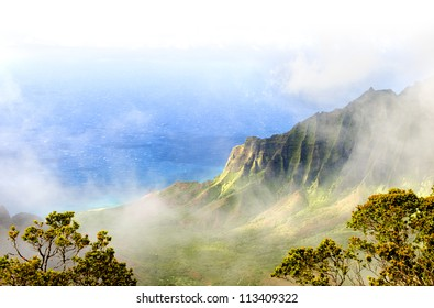 The Kalalau Valley on the Na Pali coast on the Hawaiian island of Kauai. Fades to white.