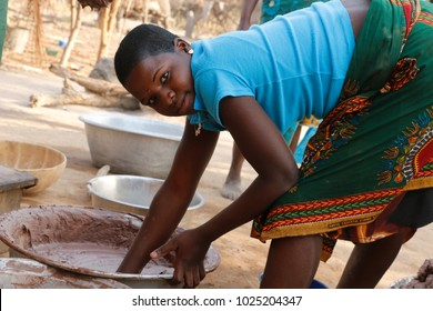 Kalale Benin December 21 2014 Woman prepairs shea butter in a big bowl