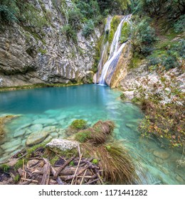 Kalamaris waterfall in river with turquoise water wide angel view, in mountain valley in peloponnese Greece