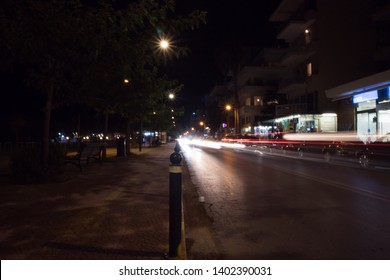 Kalamata, Greece - August 2018: Blurred picture of car lights and street lights.