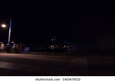Kalamata, Greece - August 2018: Blurred photo, with street lights and people.