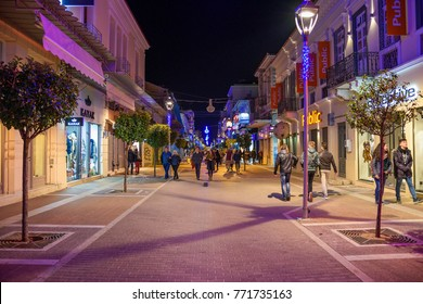KALAMATA, GREECE - DEC 8 2017: Christmas atmosphere in Kalamata city with colorful decorated streets and people walking after the Christmas tree lightning ceremony on December 8 2017. Messenia, Greece