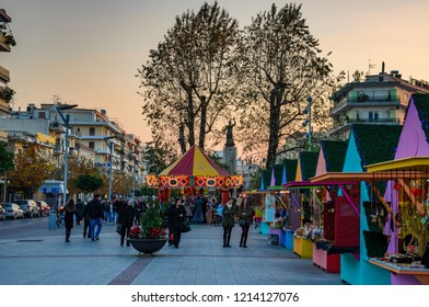 KALAMATA, GREECE - DECEMBER 2015: Christmas atmosphere in Kalamata, Greece with colorful decorated streets and people walking by the main square of the city. Messenia, Greece