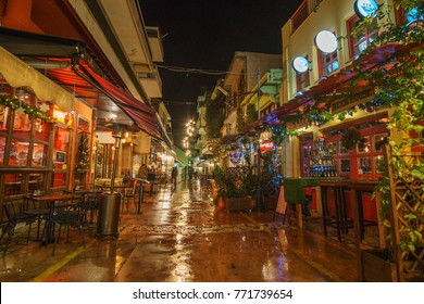 KALAMATA, GREECE - DECEMBER 2017: Christmas atmosphere with colorful decorated streets and night life in the old historical center of Kalamata city, Messenia, Greece.