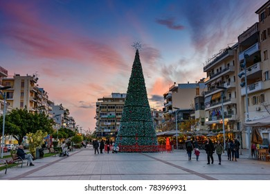KALAMATA, GREECE - DECEMBER 2017: Christmas atmosphere at the main square of the famous Kalamata city. Idyllic sunset and people walking along the square of Kalamata, Messenia, Greece, Europe