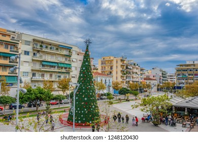 KALAMATA, GREECE - DECEMBER 2018: Christmas atmosphere in Kalamata city, Greece with colorful decorated streets and people walking by the main square of the city. Messenia, Greece