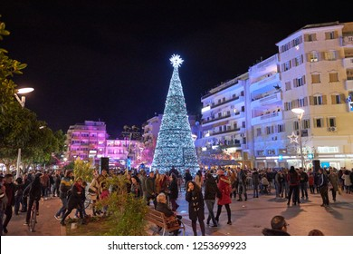 KALAMATA, GREECE - DECEMBER 7 2018: Christmas atmosphere in Kalamata, Greece with people walking by the National Christmas tree at Aristomenous square during the lighting ceremony. Kalamata, Greece