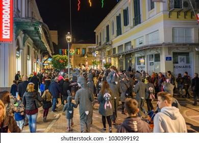 Kalamata, Greece - February 2018: Night parade during the Annual Carnival event in Kalamata (Kalamatiano Karnavali). Folk festivals, people parade in groups in Kalamata city, Peloponnese, Greece