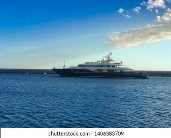 KALAMATA, GREECE - MAY 23 2019: Beautiful view of a super yacht leaving Kalamatas port in Messenia, Greece