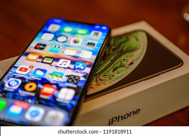 KALAMATA, GREECE - SEPTEMBER 30 2018: Close up photo of the Iphone XS model. The new Apple ten S in black color on a vintage wooden table. Concept of a modern dual camera smartphone without bezels