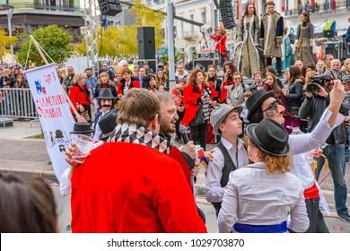 Kalamata Messenia, Greece - February 18 2018: The annual carnival in Kalamata (Kalamatiano Karnavali), folk festivals, people parade in groups in Kalamata city, Peloponnese, Greece