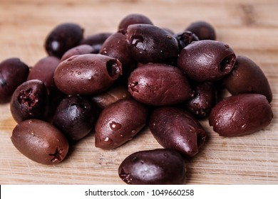 Kalamata Olives on a Wood Table