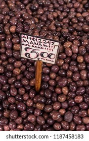 Kalamata olives These Calamata olives are found in big heaps on Greek markets. Their colors vary depending on the type and ripeness
